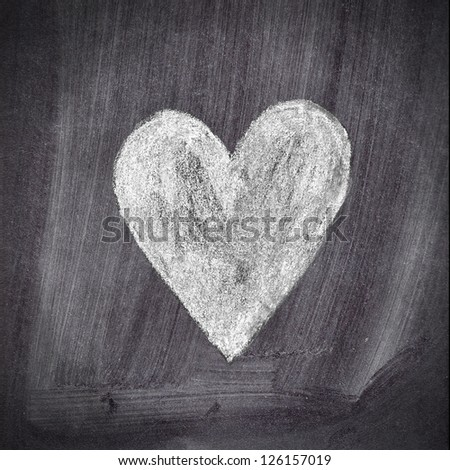 Heart shape chalk drawing on chalkboard blackboard - stock photo