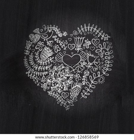 Heart shape chalk drawing on chalkboard blackboard.Floral heart. Heart made of flowers.Doodle Heart