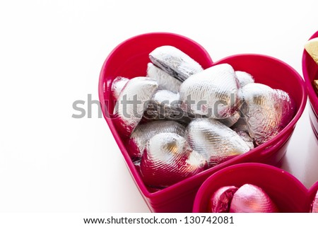 Heart shape chocolate candies wrapped in colorful foil for Valentine's Day.