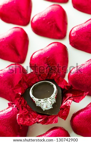 Heart shape chocolate candies wrapped in red foil for Valentine's Day.