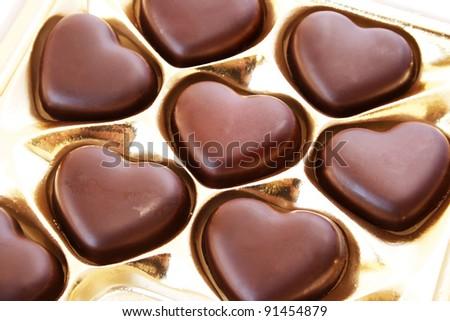 Heart shape chocolates in box.