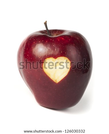 Heart shape closeup carved in red apple