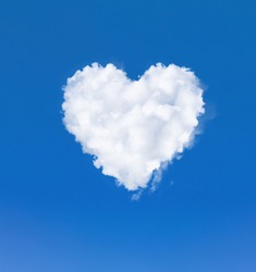 Heart shape cloud in the sky. One white cloud in a blue sky. Romantic love and health symbol