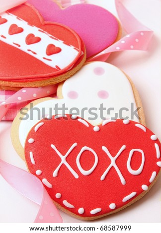 Heart-shape cookies for Valentine's Day with ribbons - stock photo