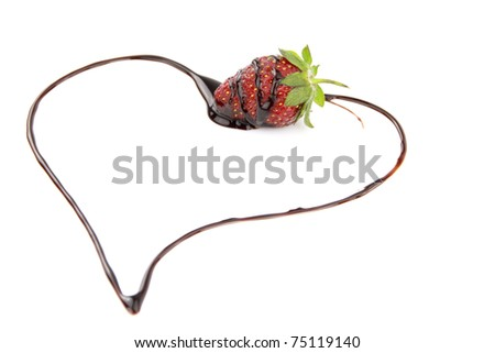Heart shape from chocolate sauce covered strawberry