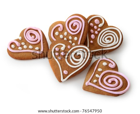 Heart shape ginger breads decorated with pink and white glazing