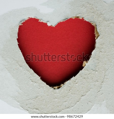 Heart shape hole through paper.