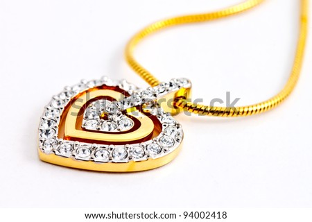 heart shape locket decorated with diamonds on white background