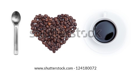 Heart shape made from coffee beans with a spoon and cup of coffee