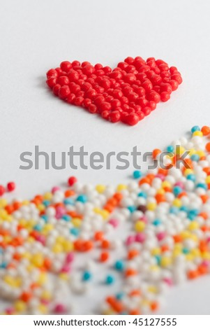heart shape made from sugar balls on white