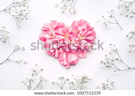 Heart shape made of flowers on white background.Flat lay. Valentines,love and wedding concept ideas #1007512339