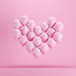 Heart shape made of Pink balloon floating on pink background. Minimal idea concept.