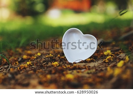 Heart shape nature flowers abstract blur background vintage style #628950026