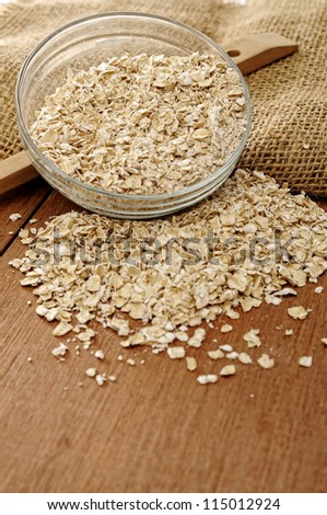 Heart shape oatmeal on wooden background. Good for healthy food concept