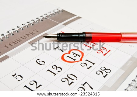 Heart shape  on calendar page showing February 14 Valentine's Day