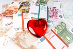 Heart shape on Euro banknotes. The heart lies on the Euro banknotes. Heart with banknotes.