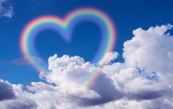 Heart shape rainbow in the sky.
