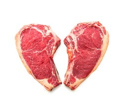 Heart shape raw dry aged beef rib steaks (cote de boeuf) isolated on white background background