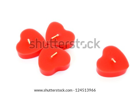 Heart shape red candles isolated on white background.