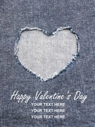 Heart shape ripped jean denim texture for Valentine's card background