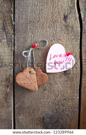"Heart shape Saint Valentine's gingerbread Cookies and cup of coffee with text ??""love you""?��, on the wooden background"