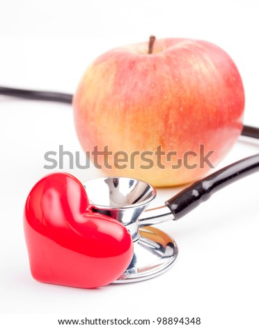 Heart-shape, stethoscope and apple isolated on white - apple keep heart concept