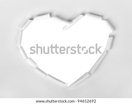 Heart shape symbol isolated over white torn paper