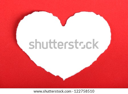 Heart shape symbol on red paper