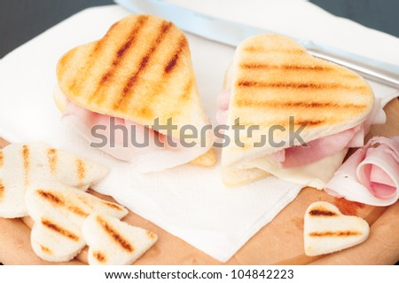 Heart shape toasted sandwiches with ham and cheese