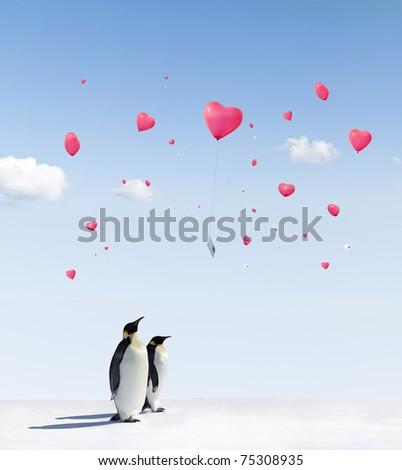 heart shaped Balloons flying over Emperor penguins in Antarctica - stock photo