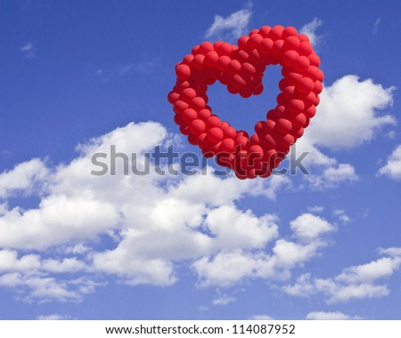 heart-shaped baloon in the sky, the symbols of love