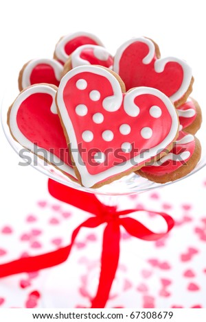Heart-shaped biscuits for Valentine's Day with red ribbon