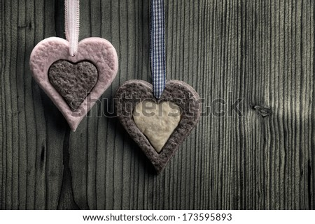 Heart-shaped biscuits with two colors - wood background #173595893