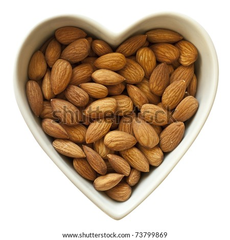 Heart shaped bowl filled with healthy almonds
