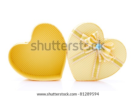 Heart shaped box with bow isolated on white background
