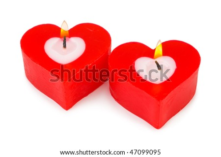Heart shaped candles isolated on white background