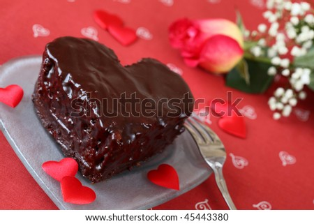 Heart shaped chocolate cake and rose