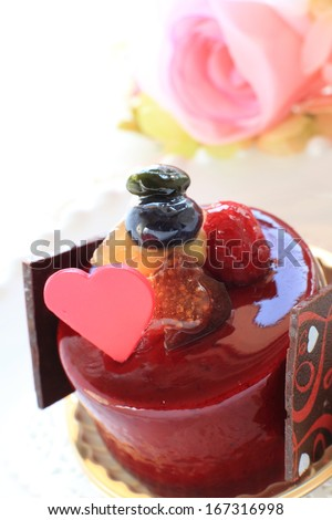 heart  shaped chocolate on raspberry cake for valentine's day dessert image