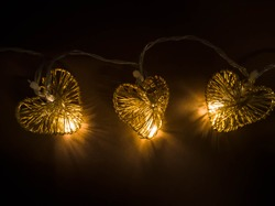 Heart - shaped Christmas fairy lights with a dark background
