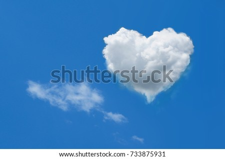 heart shaped cloud on bright blue sky white clouds #733875931