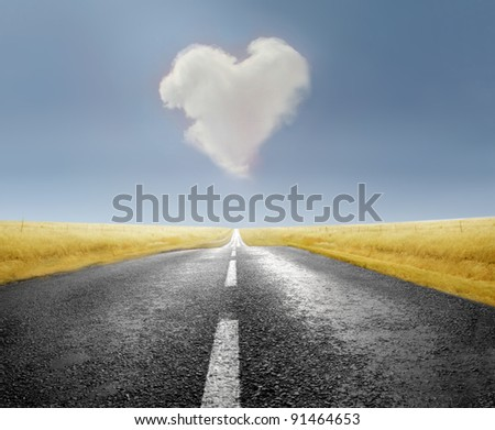 Heart-shaped cloud over a road