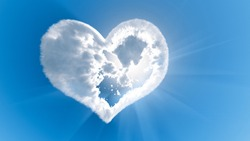 Heart shaped cloud with sun rays