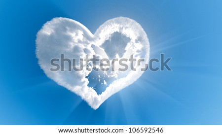 Heart shaped cloud with sun rays - stock photo