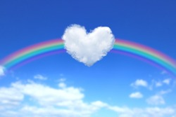 Heart-shaped clouds and rainbows in the blue sky.