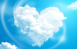 Heart shaped clouds in a blue sky