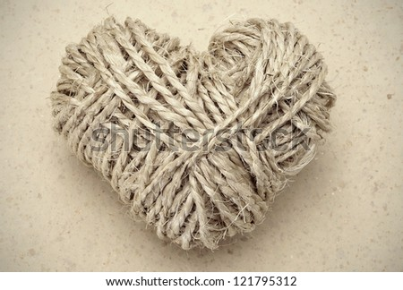 heart-shaped coil of rope on a marble background