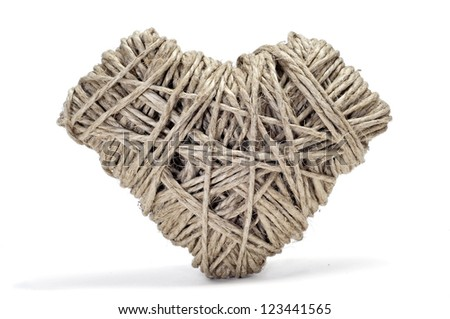 heart-shaped coil of rope on a textured background