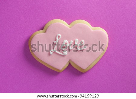 Heart shaped cookie with love text