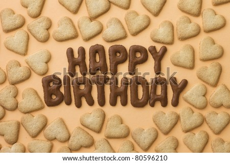 Heart-shaped cookies and letter biscuits spelling out the words Happy Birthday