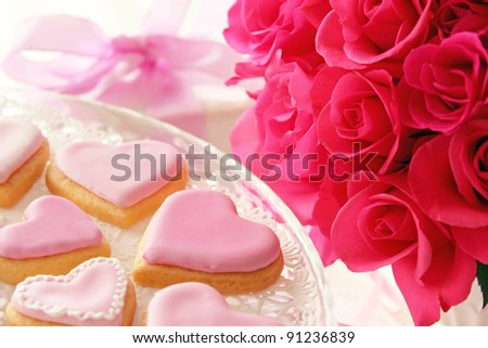 Heart shaped cookies and rose bouquet for valentine's day